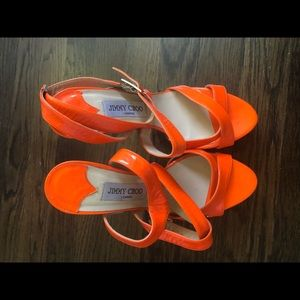 Orange Jimmy Choo patent leather heels